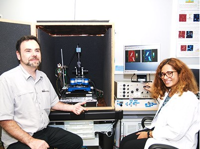 Dr Christophe Demaille and PhD student Cecilia Taofifenua in front of the JPK NanoWizard