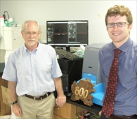 Drs Mark Davis & Devin Wiley of Caltech accept a plaque in recognition of their recent paper being the 800th citing NTA