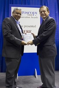 Mohan Ananth from ZEISS accepting the Microscopy Today Innovation Award for ORION NanoFab at M&M in Indianapolis USA